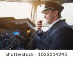 side view happy pilot talking... | Shutterstock . vector #1033214245