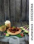 thai food deep fried beef slice ... | Shutterstock . vector #1033228366