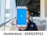 Small photo of CHIANG MAI, THAILAND - Feb 22,2018: Woman holding Apple iPhone 6S Rose Gold with Twitter app.Twitter is an online news and social networking service where users post and interact with messages.