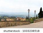 lamp posts near stone wall... | Shutterstock . vector #1033238518