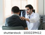 doctors are using a stethoscope ... | Shutterstock . vector #1033239412