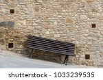 crooked bench on sloped... | Shutterstock . vector #1033239535