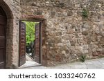 view through an open door in a... | Shutterstock . vector #1033240762