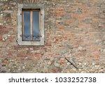 single window in old brick wall.... | Shutterstock . vector #1033252738