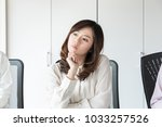 Small photo of Thinking young woman in the office.
