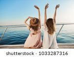 outdoor back shot of two young... | Shutterstock . vector #1033287316