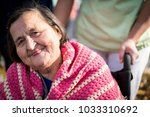 elderly people in park together | Shutterstock . vector #1033310692