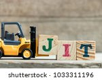toy yellow forklift hold letter ... | Shutterstock . vector #1033311196