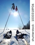 free skis with sticks near the... | Shutterstock . vector #1033318936