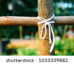 Small photo of rope bind wood