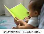 mother and baby reading a fable ... | Shutterstock . vector #1033342852