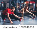 a guy and a girl in a gym doing ... | Shutterstock . vector #1033343518