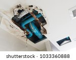 damage home ceiling in restroom ... | Shutterstock . vector #1033360888