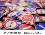 background of many road signs.... | Shutterstock . vector #1033367362