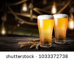 glasses of light beer with...