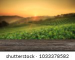 empty wooden table with view of ... | Shutterstock . vector #1033378582