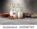 alternative types of milks.... | Shutterstock . vector #1033387765