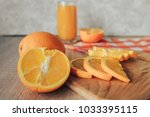 oranges on a cutting board and... | Shutterstock . vector #1033395115