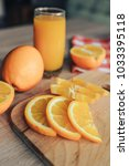 oranges on a cutting board and... | Shutterstock . vector #1033395118