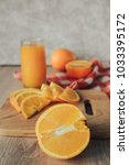 oranges on a cutting board and... | Shutterstock . vector #1033395172