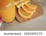 oranges on a cutting board and... | Shutterstock . vector #1033395175
