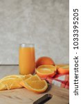 oranges on a cutting board and... | Shutterstock . vector #1033395205