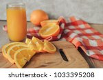oranges on a cutting board and... | Shutterstock . vector #1033395208