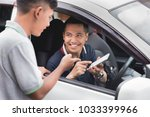 portrait of young driver... | Shutterstock . vector #1033399966
