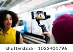 young adult woman traveling and ... | Shutterstock . vector #1033401796