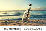 message in a bottle at the beach | Shutterstock . vector #1033413058