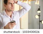 handsome young man applying... | Shutterstock . vector #1033430026