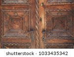 fragment of a carved wooden... | Shutterstock . vector #1033435342