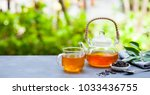 black tea in glass cup and... | Shutterstock . vector #1033436755