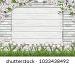white wooden sign nailed to the ... | Shutterstock .eps vector #1033438492