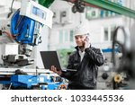 young engineer with laptop in... | Shutterstock . vector #1033445536