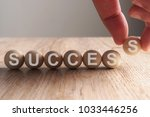 hand putting on success word... | Shutterstock . vector #1033446256