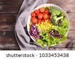 colorful vegetable salad | Shutterstock . vector #1033453438