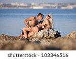 attractive couple at the sea.... | Shutterstock . vector #103346516
