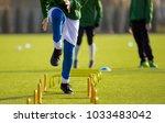 boy football player in training ... | Shutterstock . vector #1033483042