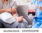 patient getting blood...   Shutterstock . vector #1033502698