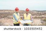 workers engineers discussing... | Shutterstock . vector #1033505452