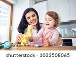 mother and child having fun...   Shutterstock . vector #1033508065
