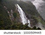 lady bowen falls  milford sound ... | Shutterstock . vector #1033509445