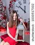 girl near the decorated... | Shutterstock . vector #1033517332