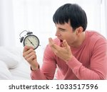 young man yawning with alarm... | Shutterstock . vector #1033517596