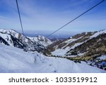 ski lift in almaty mountains.... | Shutterstock . vector #1033519912