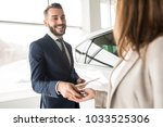 portrait of handsome car... | Shutterstock . vector #1033525306