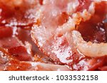 sliced fried bacon selective... | Shutterstock . vector #1033532158