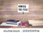 how do you feel. wooden table... | Shutterstock . vector #1033534936