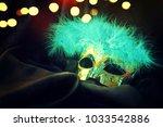 carnival mask background | Shutterstock . vector #1033542886